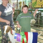 Christopher Spencer Wins Champion Market Goat at the Fair