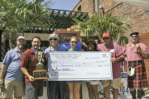 Left To Right: KNCO's Tom Fitzsimmons, Rick Tracewell -2013 Penny Pitch Champion, KNCO's Joe Hevia, Nicola Murphy- DVSAC Board of Director's Chair, Gayle-Guest Brown - DVSAC Executive Director, Kanes Owner John Kane,  Kevin Fraser- Penny Pitch Competition Judge